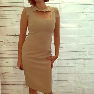 Tan or cream colored dress, knee length